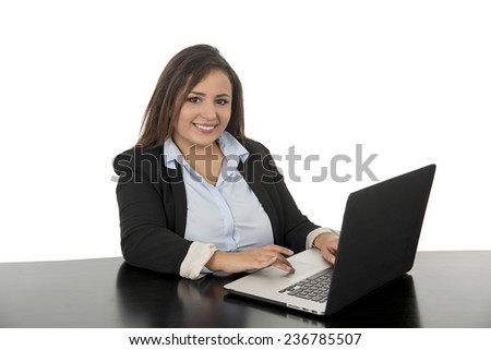young business woman smiling with laptop against a white background - stock photo