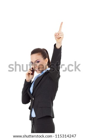 young business woman speaking on mobile phone and finger pointing up to empty copy space, isolated on white background - stock photo