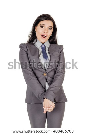 young business woman standing with shy smile, using reassuring body language to express satisfaction. - stock photo