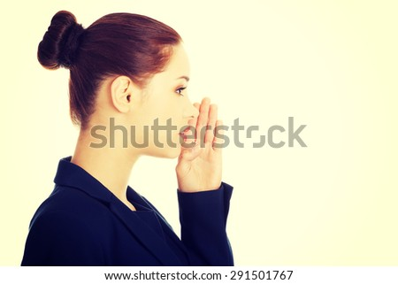 Young business woman talking gossip - stock photo