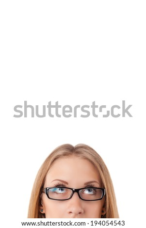 Young business woman thinking of her plans closeup face portrait - stock photo