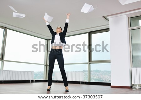 young business woman throw papers and documents from joy in air representing concept of freedom joy and stress control - stock photo