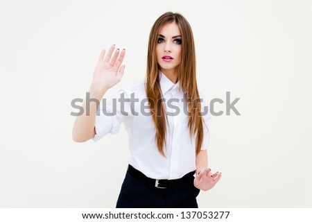 Young business woman touching virtual screen on white background studio medium shot portrait - stock photo