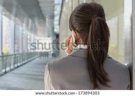 Young business woman use cellphone, rear view and closeup portrait. - stock photo