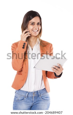 Young business woman using a tablet and a smart-phone at the same time - stock photo
