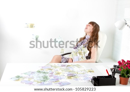 young business woman with a lot of money - stock photo
