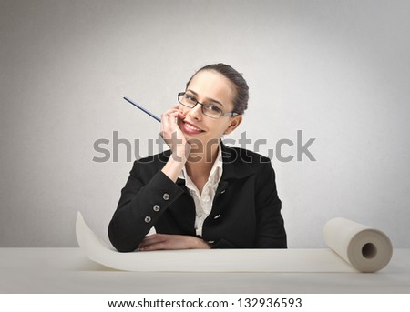young business woman with a pencil and a blank roll paper - stock photo