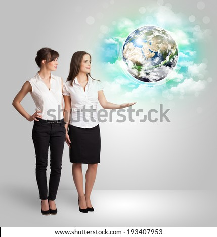 Young business woman with earth and cloud concept - stock photo