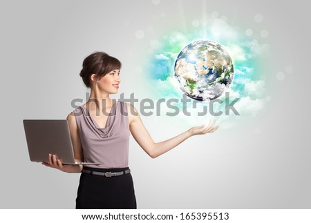 Young business woman with earth and cloud concept(NASA imagery) - stock photo