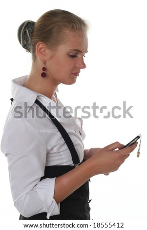 Young business woman with mobile phone in her hand - stock photo