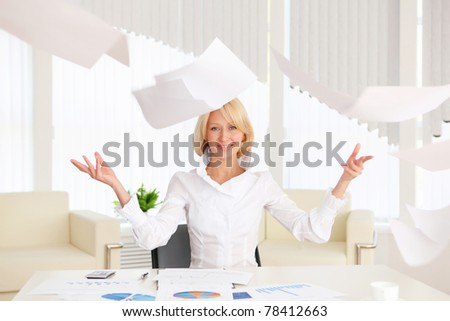 young business woman with papers flying up - stock photo