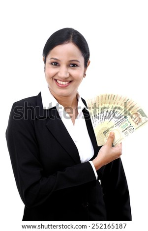 Young business woman with rupee notes in her hands, isolated on white background - stock photo