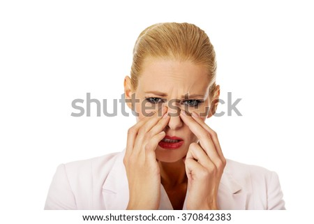 Young business woman with sinus pressure pain - stock photo
