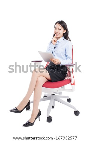 young business woman with tablet computer sitting on the chair, isolated on white background - stock photo