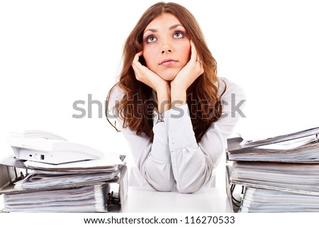 Young business woman working at her office and thinking - stock photo
