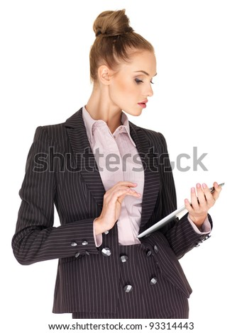Young business woman working on tablet - stock photo