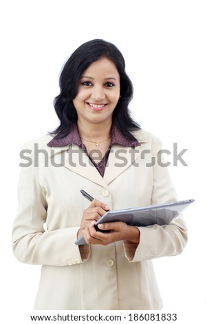 Young business woman working with tablet against white - stock photo