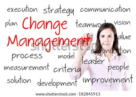 Young business woman writing change management concept. Office background. - stock photo