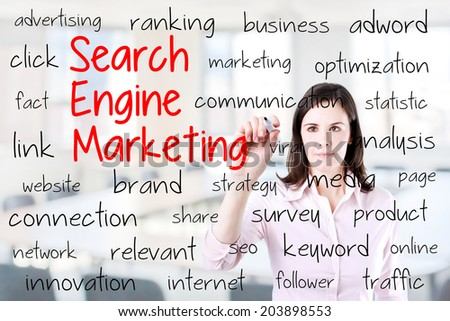 Young business woman writing search engine marketing concept. Office background. - stock photo