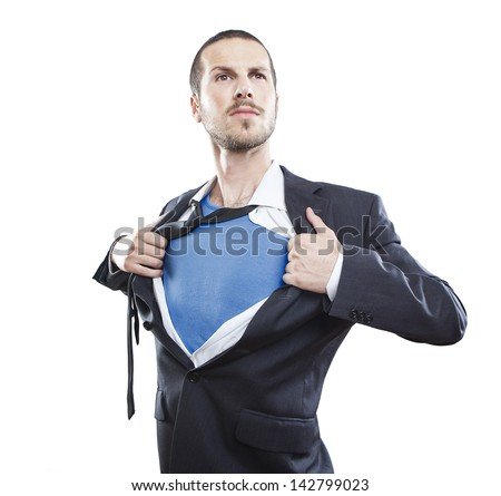 Young businessman acting like a super hero and tearing his shirt off - stock photo