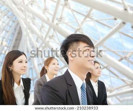 young businessman and businesswoman stand in the modern office - stock photo