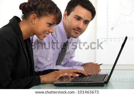 young businessman and businesswoman working together - stock photo