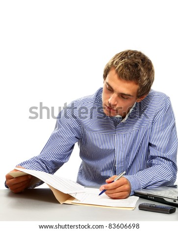 Young businessman  at his workplace, signing documents, isolated on white background - stock photo