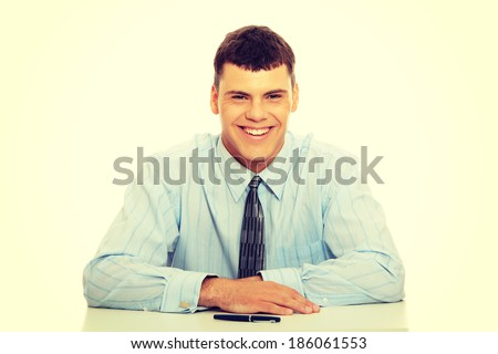 Young businessman behind the desk - stock photo