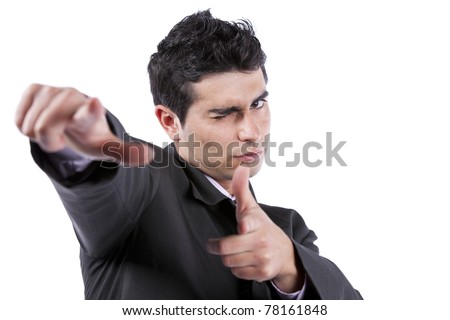 Young businessman blinking his eye and pointing to you (isolated on white) - stock photo
