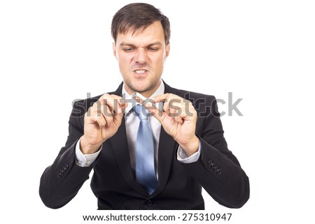 Young businessman breaking a cigarette, concept for give up smoking, isolated over white background - stock photo