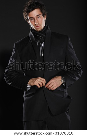 Young Businessman Buttoning Jacket - stock photo