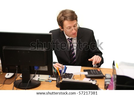 young businessman calculating - stock photo