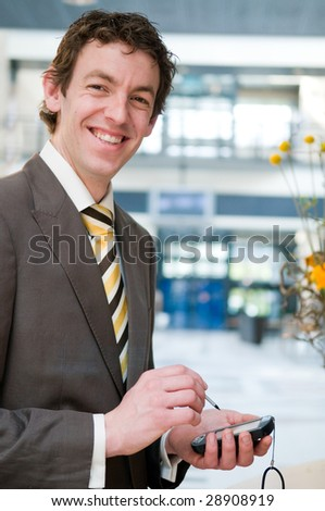 Young businessman checking his appointment at the front desk - stock photo