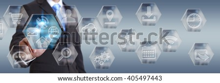Young businessman clicking on digital application icons interface - stock photo