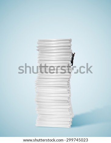young businessman climbing up a huge big stack of paper - stock photo