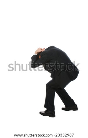 Young businessman covering his head - stock photo