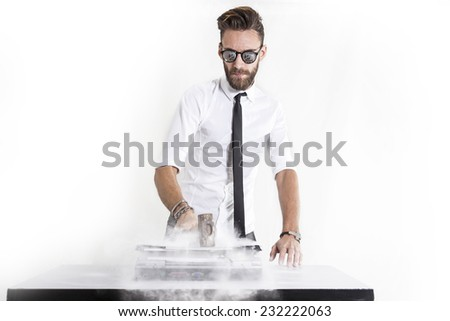 young businessman destroying laptop computer - stock photo