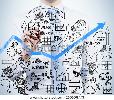young businessman drawing business strategy, close up - stock photo