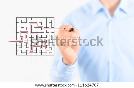 Young businessman drawing success way to find solution concept. Isolated on white. - stock photo