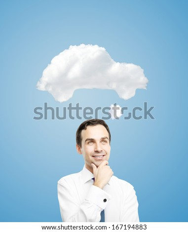 young businessman dreaming of a new car - stock photo
