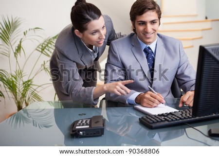 Young businessman explaining her colleague what he has to do - stock photo