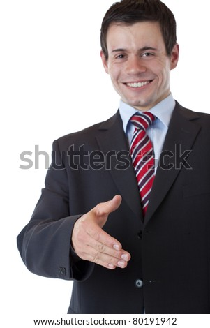 Young businessman gives hand for warm welcome. Isolated on white background. - stock photo