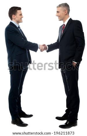 Young businessman handshaking on a white background - stock photo