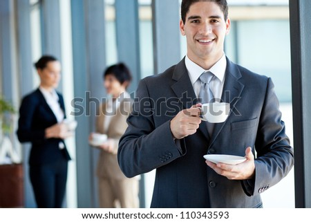 young businessman having coffee break in office - stock photo