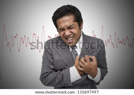 Young businessman having heart attack - stock photo