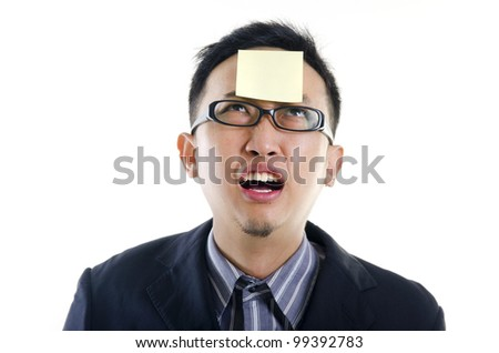 young businessman helpless looking the post it - stock photo