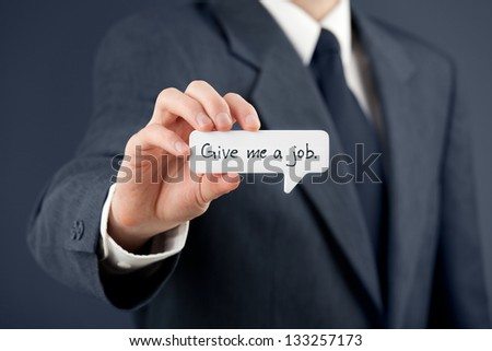 Young businessman hold comics bubble with text Give me a job. Unemployed person (jobless, out of work) concept. - stock photo