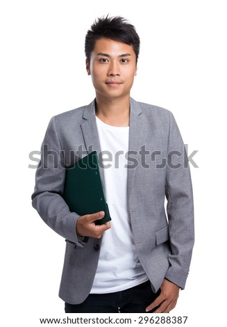 Young businessman hold with file board - stock photo