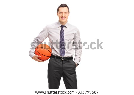 Young businessman holding a basketball and looking at the camera isolated on white background - stock photo