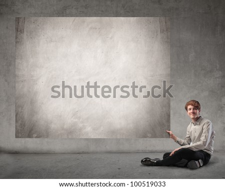 Young businessman holding a board - stock photo